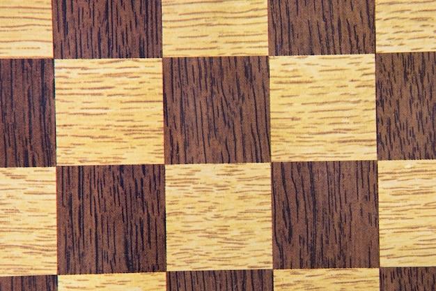 Makrobild des schachbretts für tapetenbraun