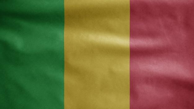 Malische flagge weht im wind. mali-banner bläst glatte seide. stoff stoff textur fähnrich hintergrund.