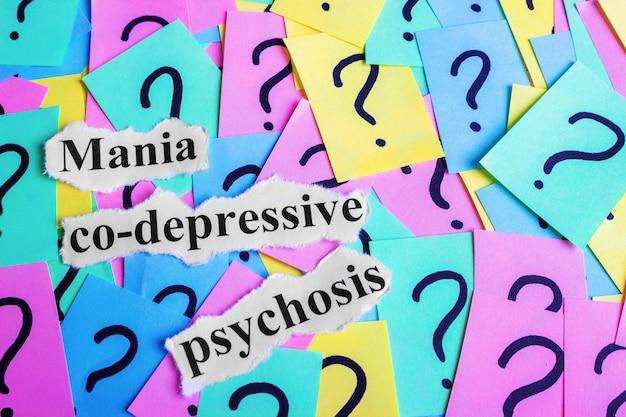 Mania co-depressive psychose-syndrom-text auf bunten haftnotizen