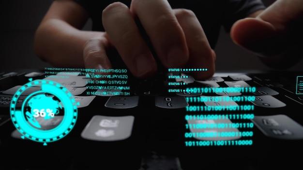 Mann, der an laptop-computertastatur mit grafischem benutzeroberflächen-gui-hologramm arbeitet, das konzepte der big-data-wissenschaftstechnologie zeigt