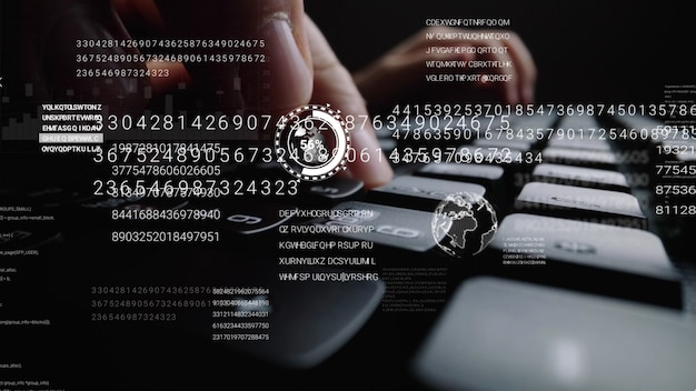 Mann, der an laptop-computertastatur mit grafischer benutzerschnittstelle arbeitet