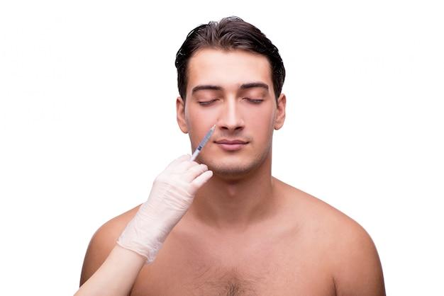 Mann, der die plastische chirurgie lokalisiert auf weiß durchmacht