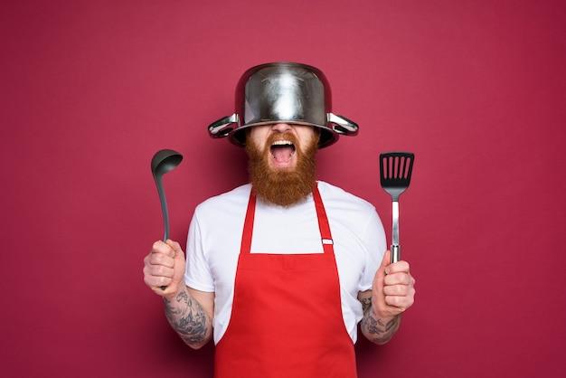 Mann koch ist bereit, im hintergrund der küchenburgunder zu kämpfen
