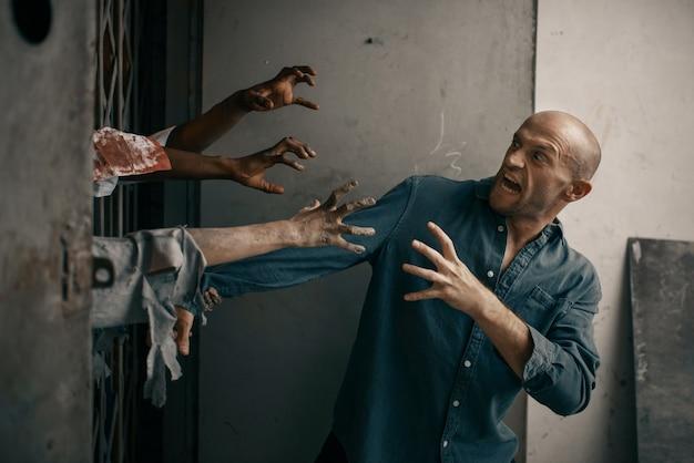 Mann läuft weg von der zombiearmee, apokalypse