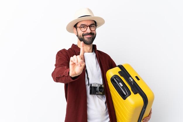 Mann mit dem bart, der geht, über lokalisierte wand zu reisen