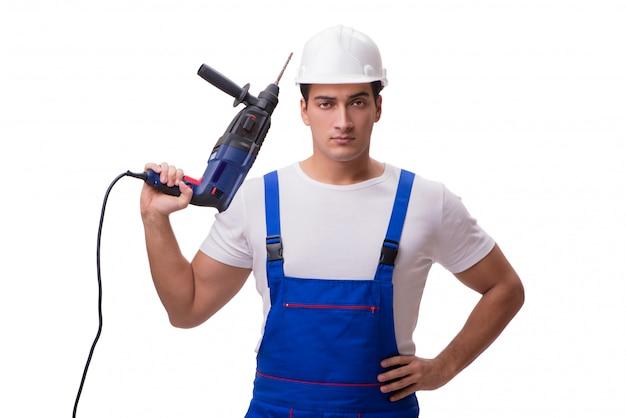 Mann mit dem bohrgerät getrennt auf dem weiß