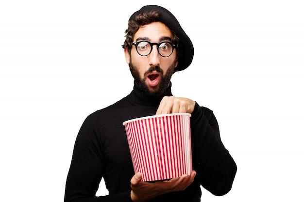Mann mit einer schüssel popcorn