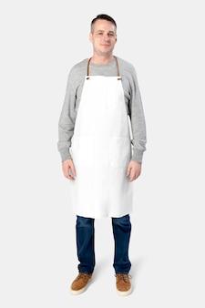 Mann mit weißer schürze auf weiß