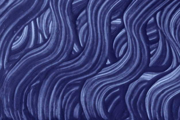 Marineblaue farben des abstrakten kunsthintergrunds. aquarellmalerei auf leinwand mit indigofarbenen strichen und spritzwasser