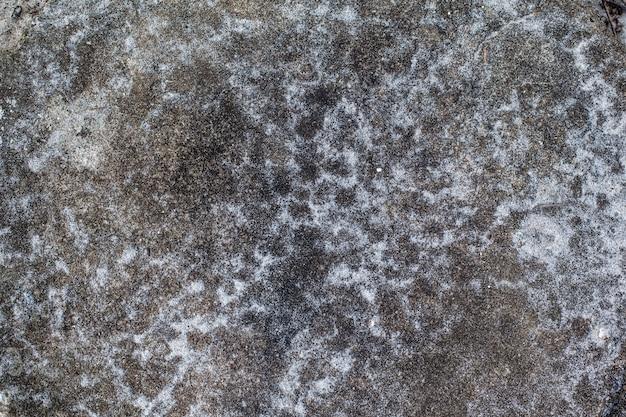 Marmorstein auf weißem sandgebrauch des bodens für hintergrund.