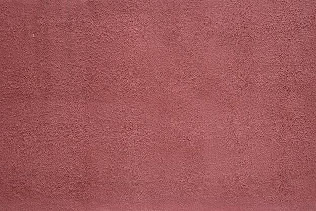 Maroon hintergrund textur zementwand. textur der farbe auf gerilltem putz.