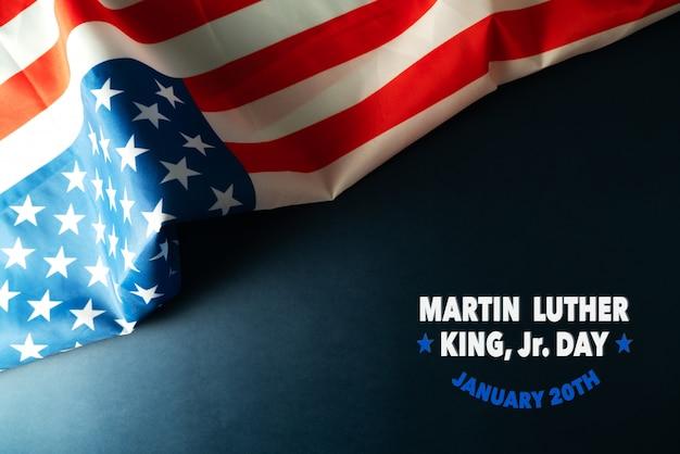 Martin luther king day anniversary - abstrakter hintergrund der amerikanischen flagge