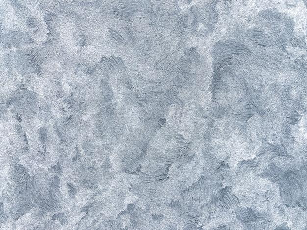 Masern sie den dekorativen blauen gips, der den alten schalenwandhintergrund nachahmt