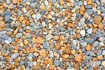Masern Sie Hintergrund von bunten Kieseln auf dem Boden