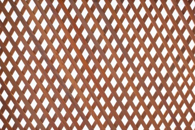 Matten. die textur ist braun und weiß, das gitter oder gitter ist diagonal.