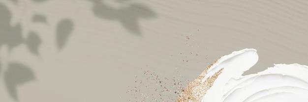 Mattgrüner hintergrund mit blattschatten und goldglitter