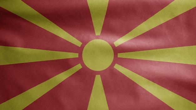 Mazedonische flagge weht im wind. nordmazedonien-banner bläst glatte seide. stoff textur fähnrich hintergrund.