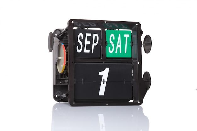 Mechanischer kalender retro datum 1. september, am isolierten ersten schultag.
