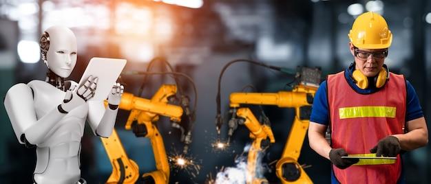 Mechanisierter industrieroboter und menschlicher arbeiter arbeiten in zukünftiger fabrik zusammen