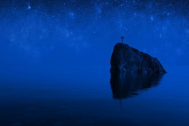 Meeresfelsen mit kreuz oben im mondlicht