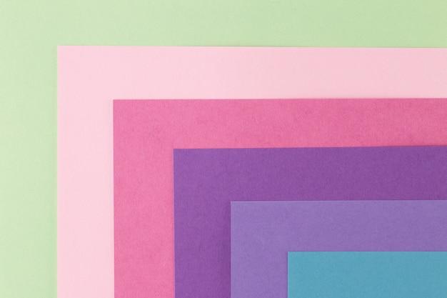 Mehrfarbenhintergrund von einem papier von verschiedenen farben, draufsicht