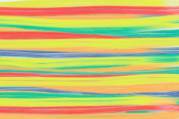 Mehrfarbige farbe auf der leinwand, gestreifter gemalter hintergrund, tintenlinienstruktur, buntes aquarellmuster. abstrakte gelbe zeichnung. buntkunsttapete. malerei-design.