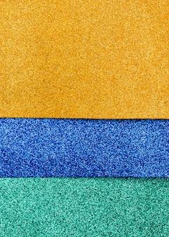 Mehrfarbige glitzerschichten mit kopierraum
