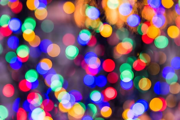 Mehrfarbige lichter bokeh beschaffenheit. weihnachtslichter verwaschen