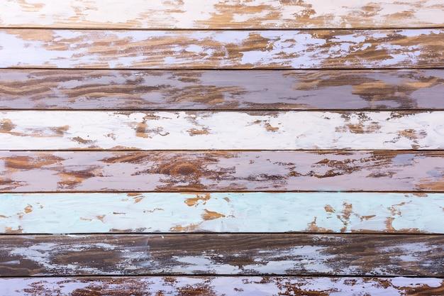 Mehrfarbiger alter hölzerner plankenhintergrund. horizontale streifen