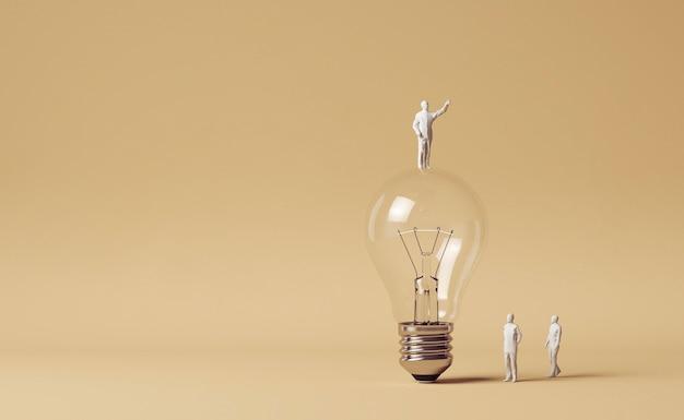 Menschliche figuren stehen neben glühbirne