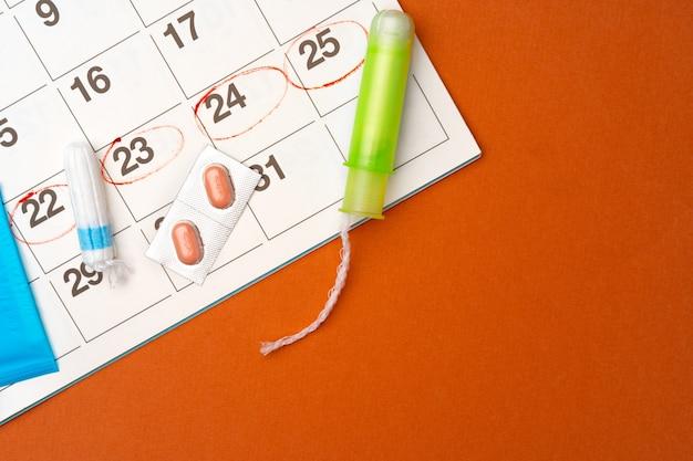 Menstruationskalender mit binden und tampons