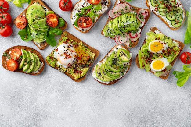 Menühintergrund mit verschiedenen verschiedenen veganen sandwiches