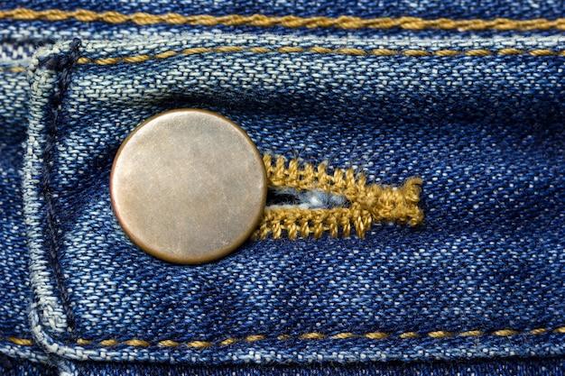 Messingknopf der weinlese blue jeans