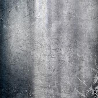 Metallischer hintergrund mit einem grunge-kratzeffekt