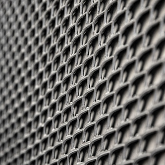 Metallischer hintergrundzaun in grautönen
