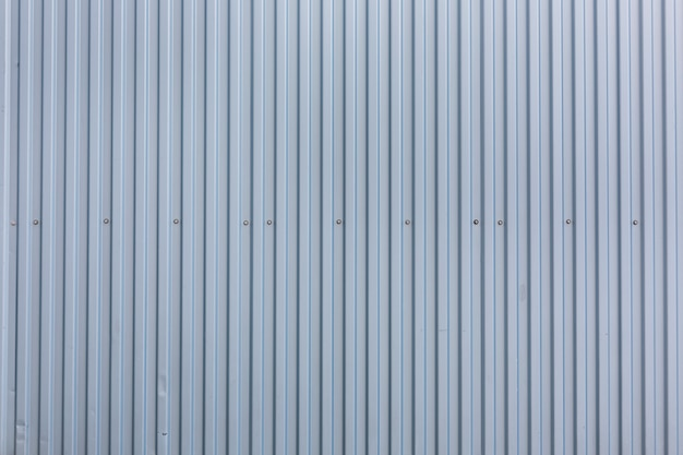 Metalloberfläche mit vertikalem streifenbeschaffenheitshintergrund