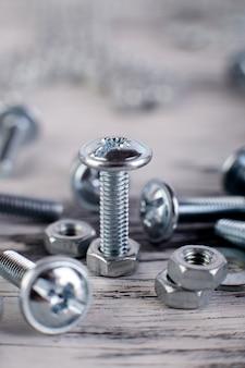Metallschrauben und -muttern oberfläche, makro, arbeitsgeräte,