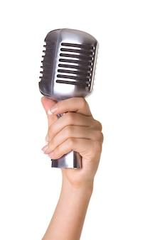 Mikrofon im retro-stil in der hand