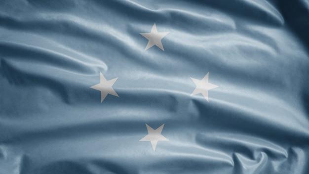 Mikronesische flagge weht im wind. nahaufnahme von mikronesien banner weht, weiche und glatte seide