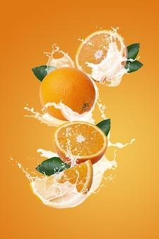 Milchspritzer auf orangenfrucht und orangenscheibe isoliert auf einem orangefarbenen hintergrund