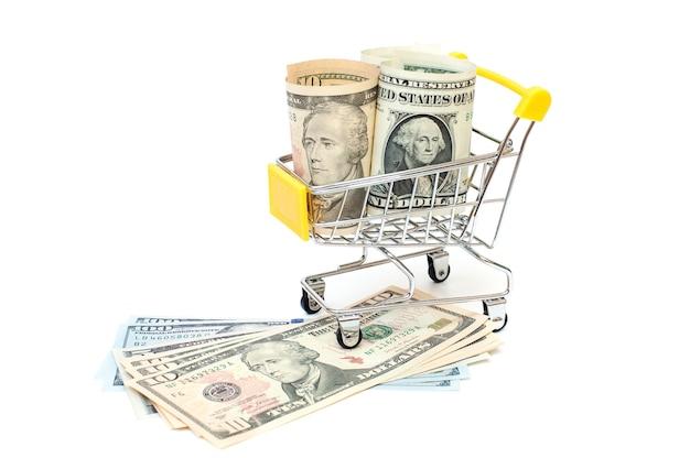 Mini-wagen mit 1 und 10-dollar-banknoten innen auf weißem hintergrund wagen und geld finanzkonzept kopierraum