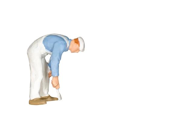 Miniaturleute: maler, der eine bürste lokalisiert auf weiß und beschneidungspfad hält