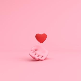 Minimale szene der hand, die schwebendes herz, valentinskonzept hält.