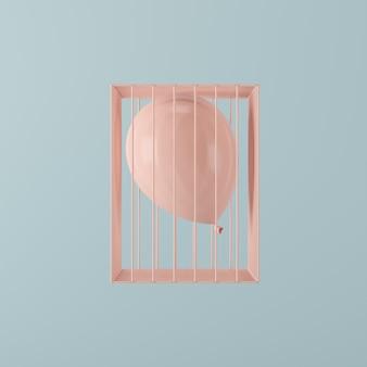 Minimaler konzeptrosaballon, der in rosa käfig auf blauem hintergrund schwimmt