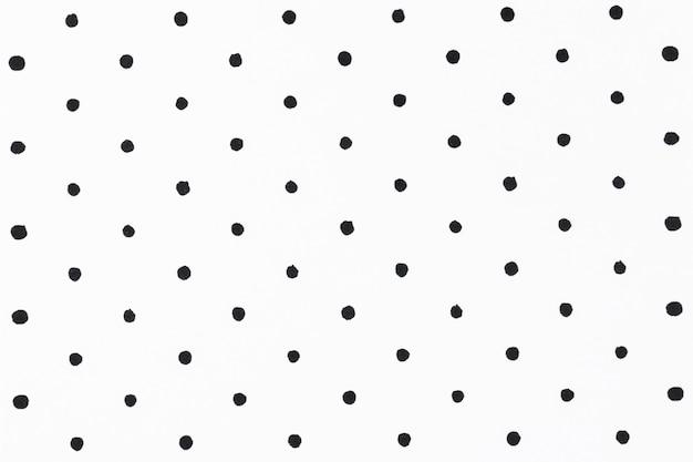 Minimaler weißer hintergrund mit schwarzem tupfenmuster