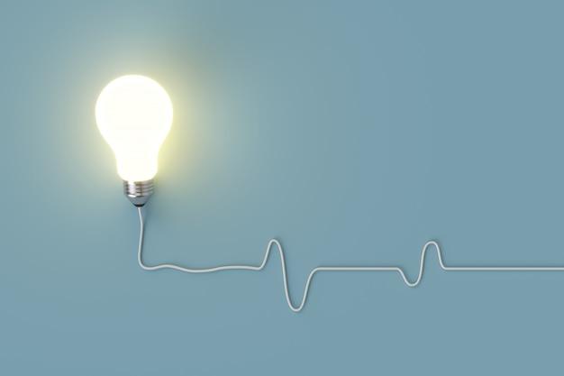 Minimales konzept. hervorragende glühende glühbirne mit kabel auf blauem hintergrund für textfreiraum.