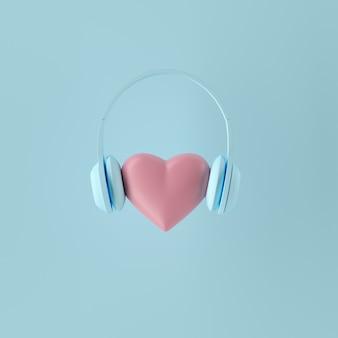 Minimales konzept. hervorragende rosa farbherzform mit blauem kopfhörer auf blauem hintergrund. 3d rendern