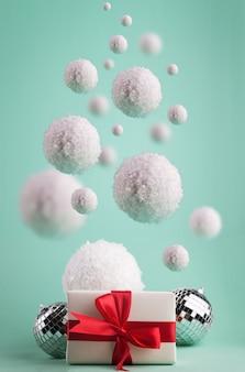 Minimalistische weihnachtskomposition mit big flying snowballs und goft box.