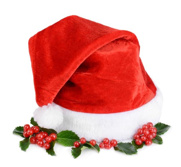 Mistelblätter mit weihnachtsmütze isoliert auf weiß