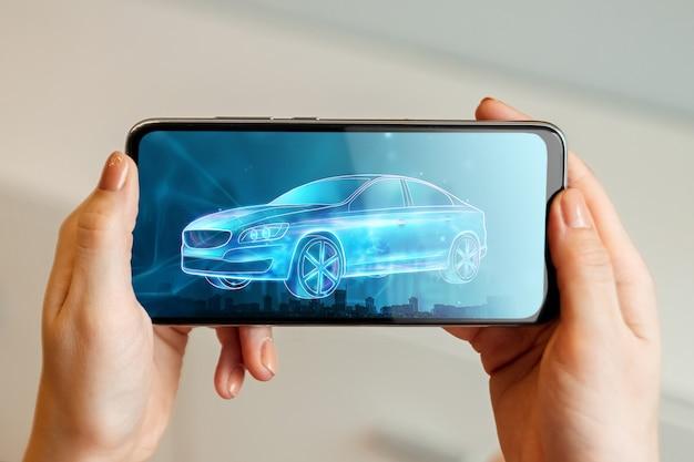 Mobile gps-navigation, hologrammbild eines autos, das den smartphonebildschirm verlässt.